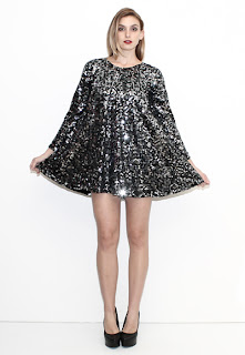 Vintage 1970's silver sequin mini party swing dress with long sleeves.
