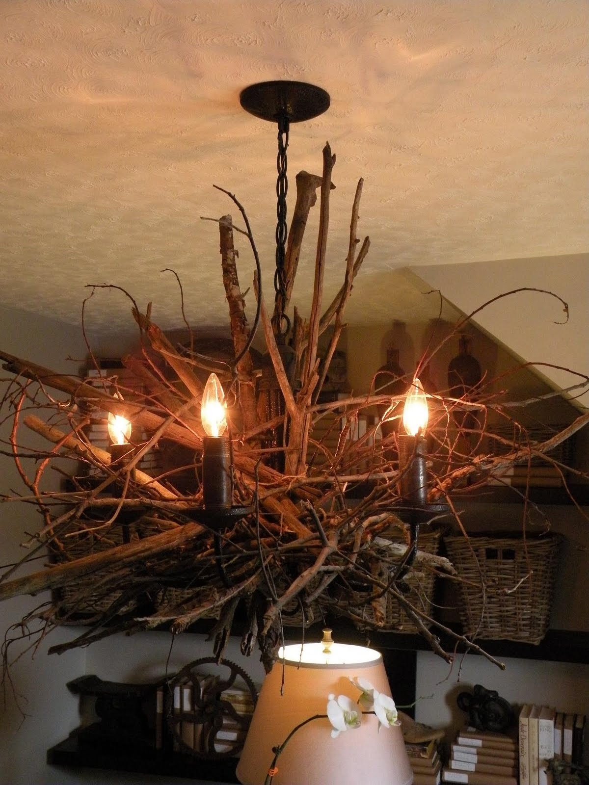 Oliver and Rust Returning with a twig chandelier