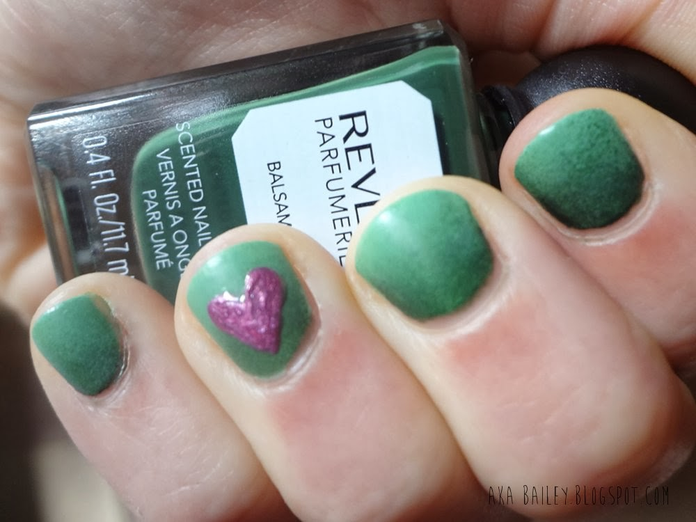 Mint and emerald ombre nails with an orchid heart accent