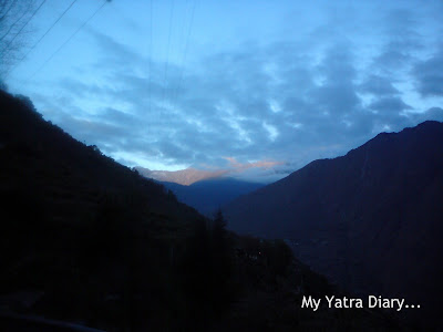 Mountains, cloud cover and sunrise in the Garhwal Himalayas