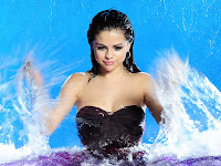 Selena Gomez sexy cleavage in photoshoot for her new Fragrance