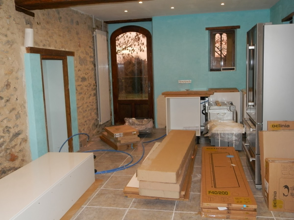 As for the rest of the kitchen, we've painted the walls, papered over