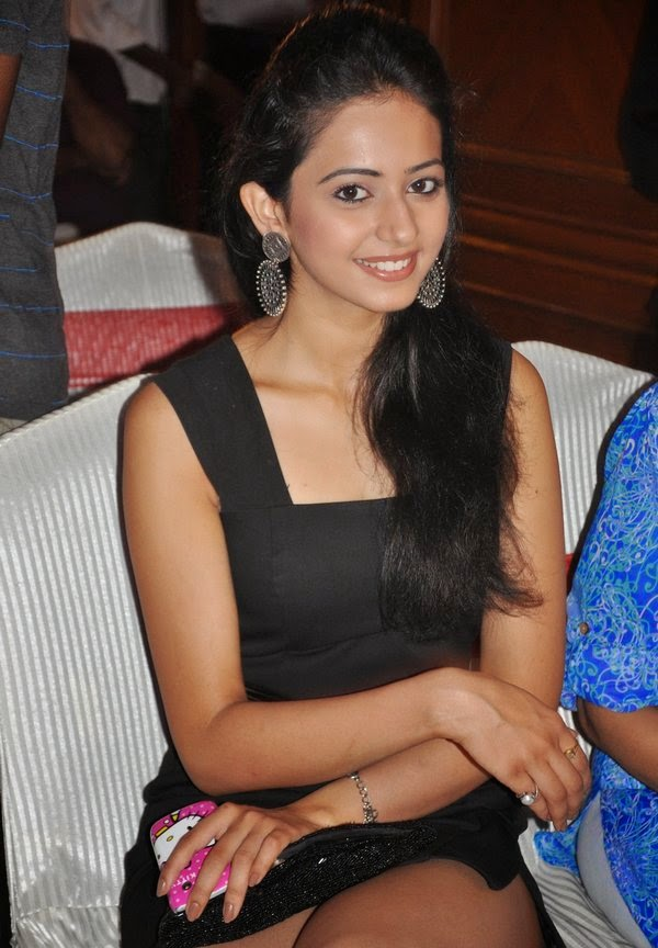 Sexy Rakul Preet Singh exposing her sexy thunder thighs in black mini skirt backless dresses