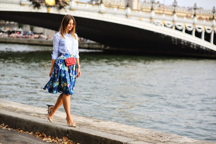 blue shirt and floral skirt, red little bag
