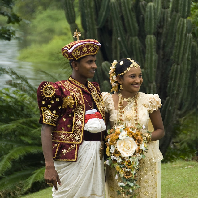 Sri Lankan bride and groom in traditional wedding outfit
