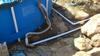 Close-up of the connecting tails that link the new underground pipework to the inlet and outlet on the side of the pool