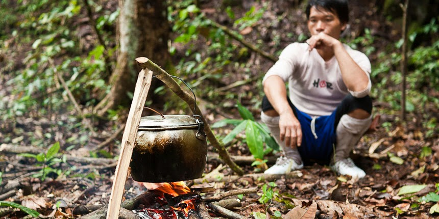 cooking coffee in the Bahau Hulu rainforest, East Kalimantan, Indonesia