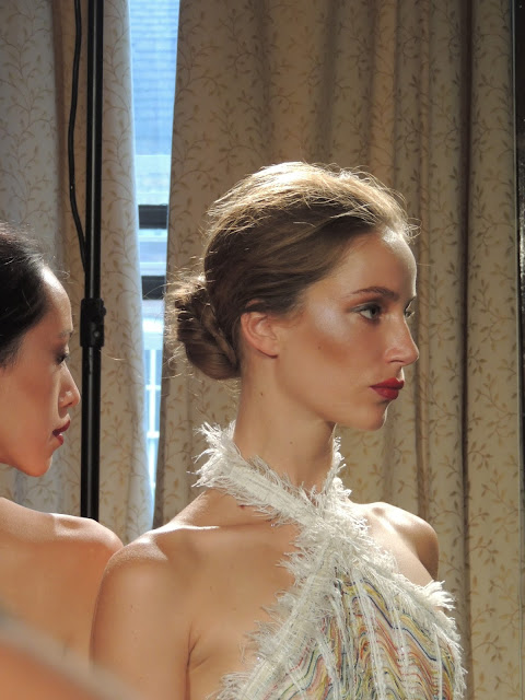 Polished make-up with bronze cheeks and red lipstick at Hellen Van Rees