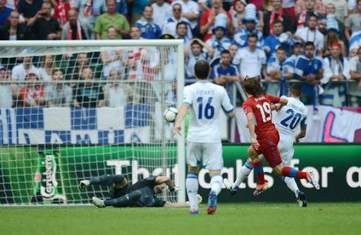 Czech midfielder Petr Jiráček scores in the nets of Greek goalkeeper Kostas Chalkias