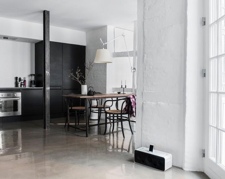 small Copenhagen apartment open floor plan glossy concrete floors