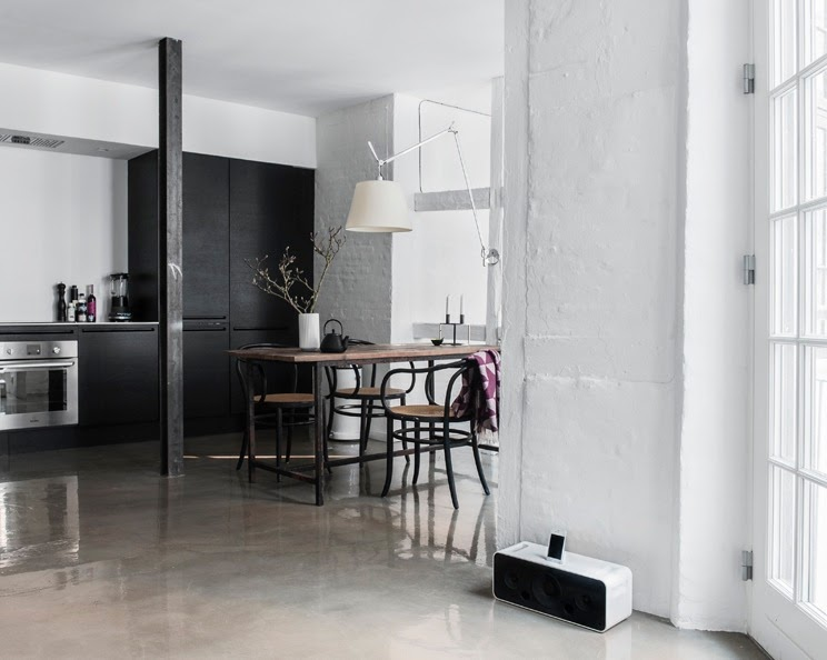small Copenhagen apartment open floor plan glossy concrete floors