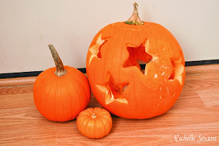 star pumpkin with small pumpkins