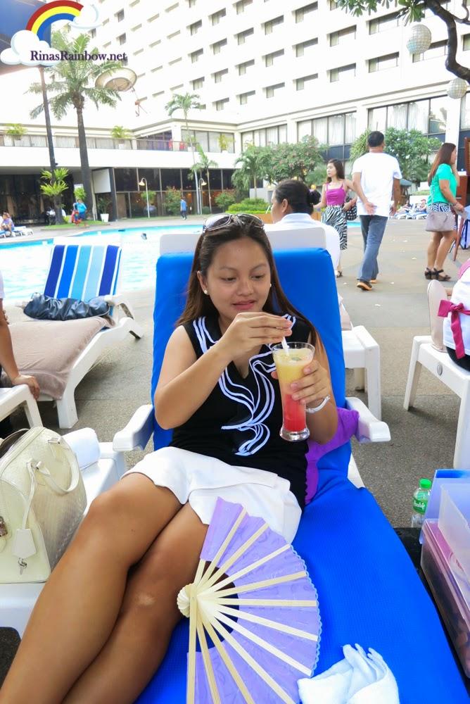 Drinking slush by the pool