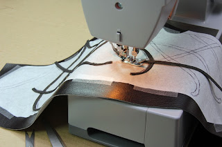 Sewing lace on the vest of Elrond's costume.