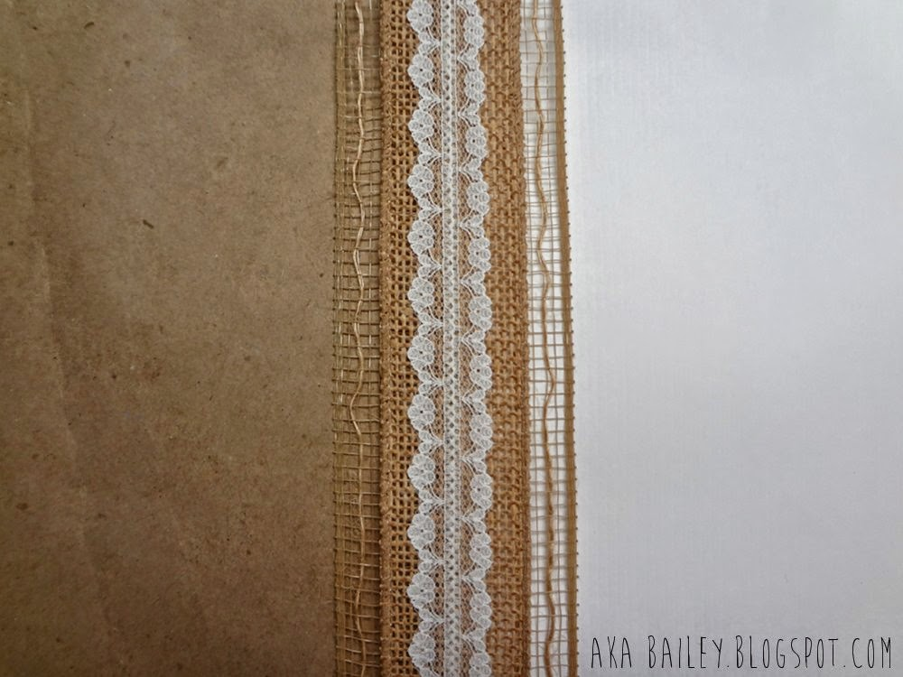 Brown and white gift wrap with burlap ribbon and lace