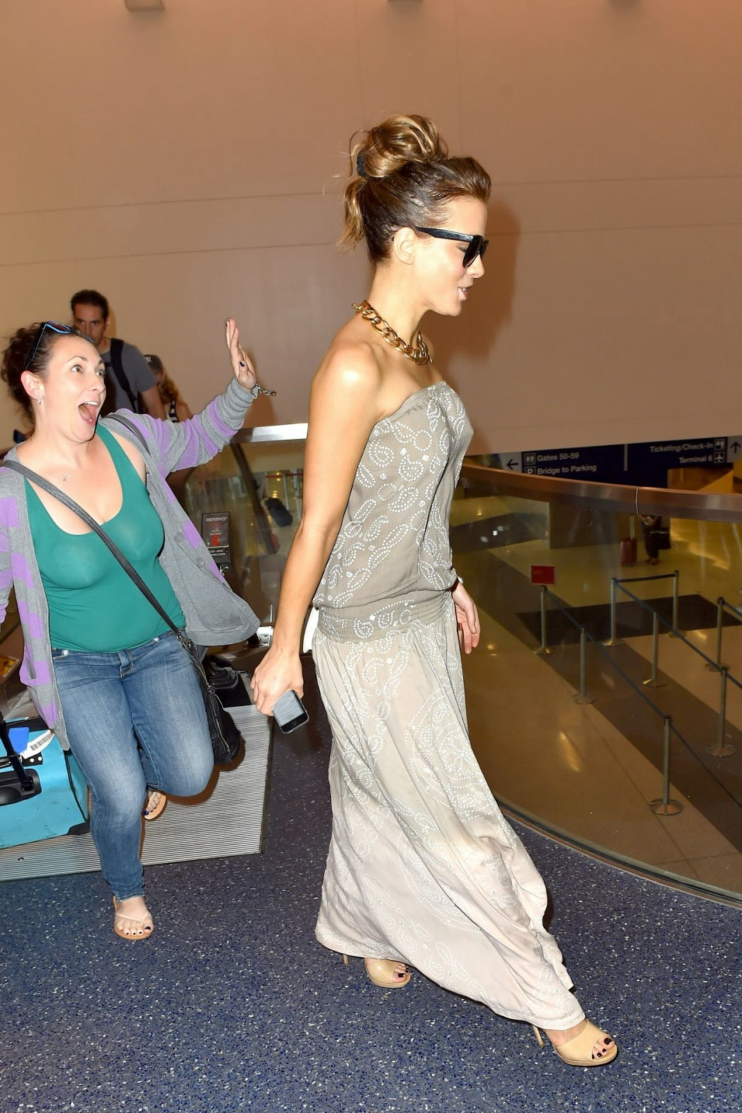 Kate Beckinsale is stylish in a strapless maxi dress at LAX Airport LA