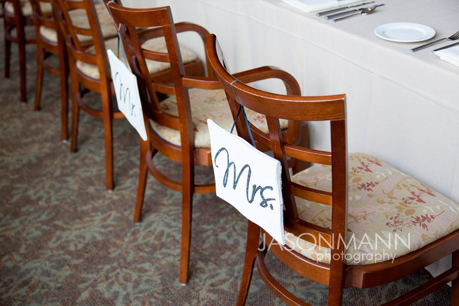 Mr and Mrs wedding reception chairs. Photo by Jason Mann Photography, 920-246-8106, www.jmannphoto.com