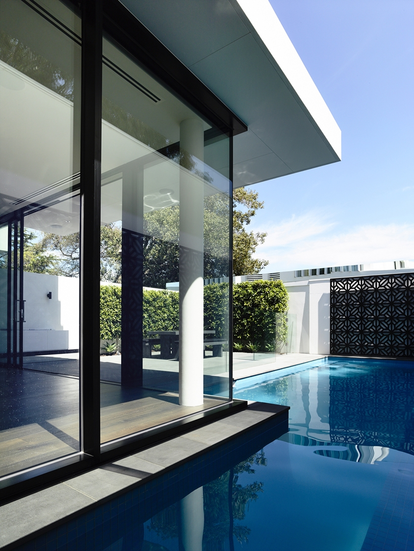 Glass wall and swimming pool in Perfect Modern Townhouse by Martin Friedrich Architects