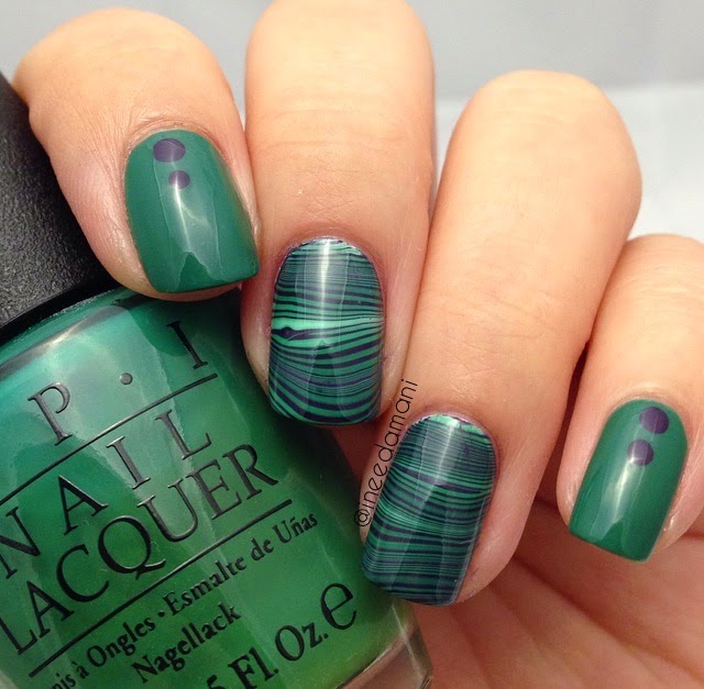 opi jade is the new black opi vant to bite my neck green and purple water marble nails