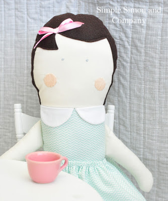 Cloth Doll with embroidered face and felt hair seated