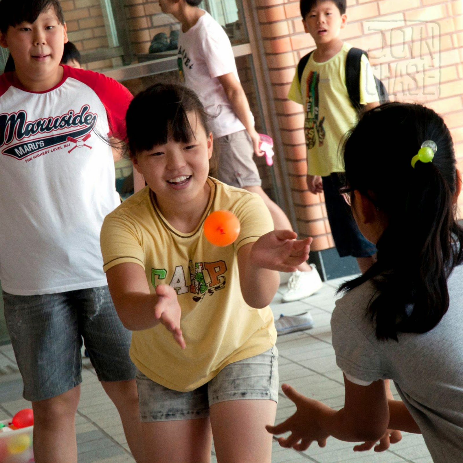 Korean students tossing a water balloon in South Korea.