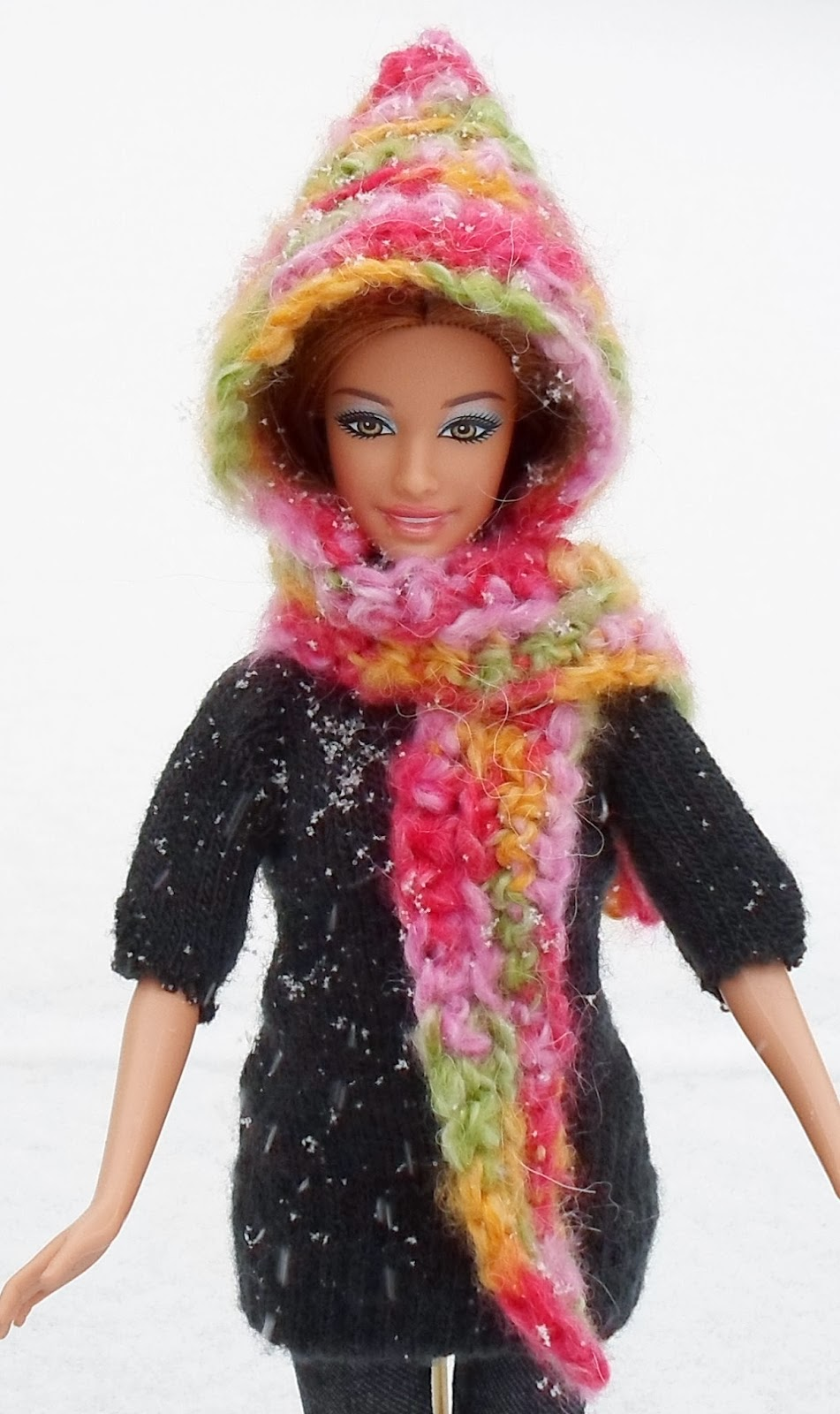 http://happierthanapiginmud.blogspot.com/2014/01/easy-hooded-scarf-for-barbie-crochet.html