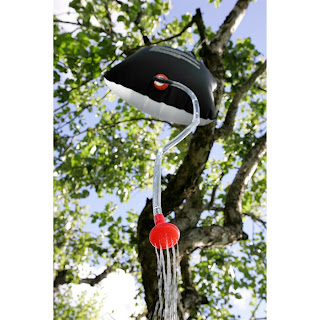 Simple camp shower, hanging from the tree