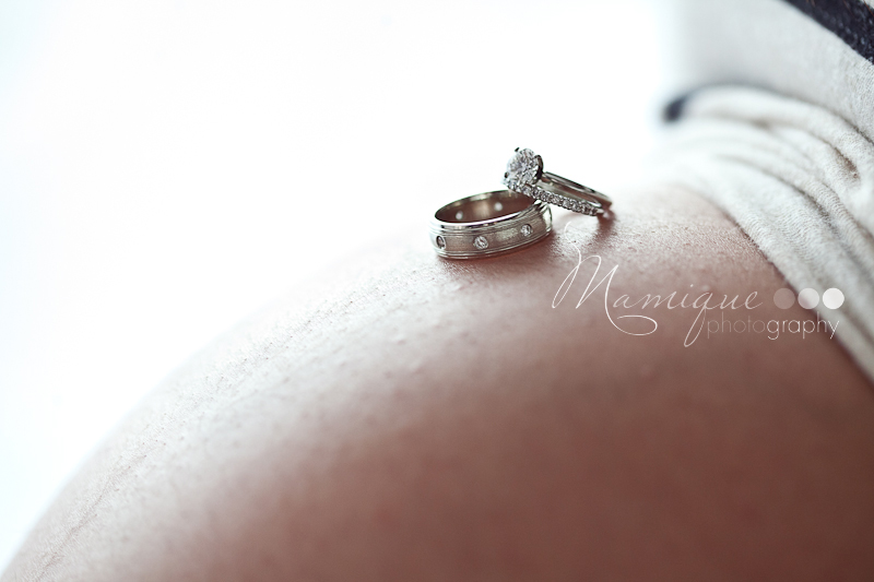 Maternity photo with wedding rings on belly