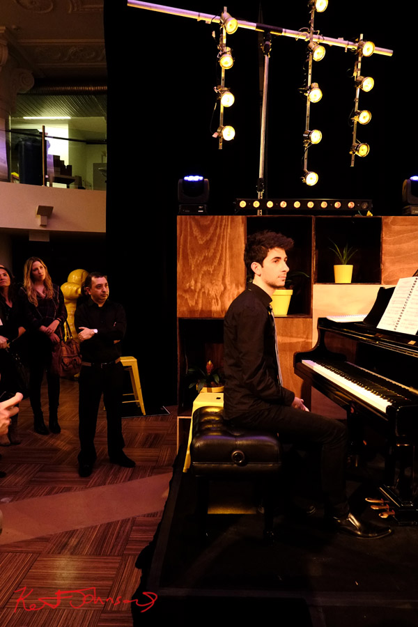 A pause in the music, at the piano, pianist Alex Raineri with Andreas Ottensamer 'Yellow Lounge' Street Fashion Sydney