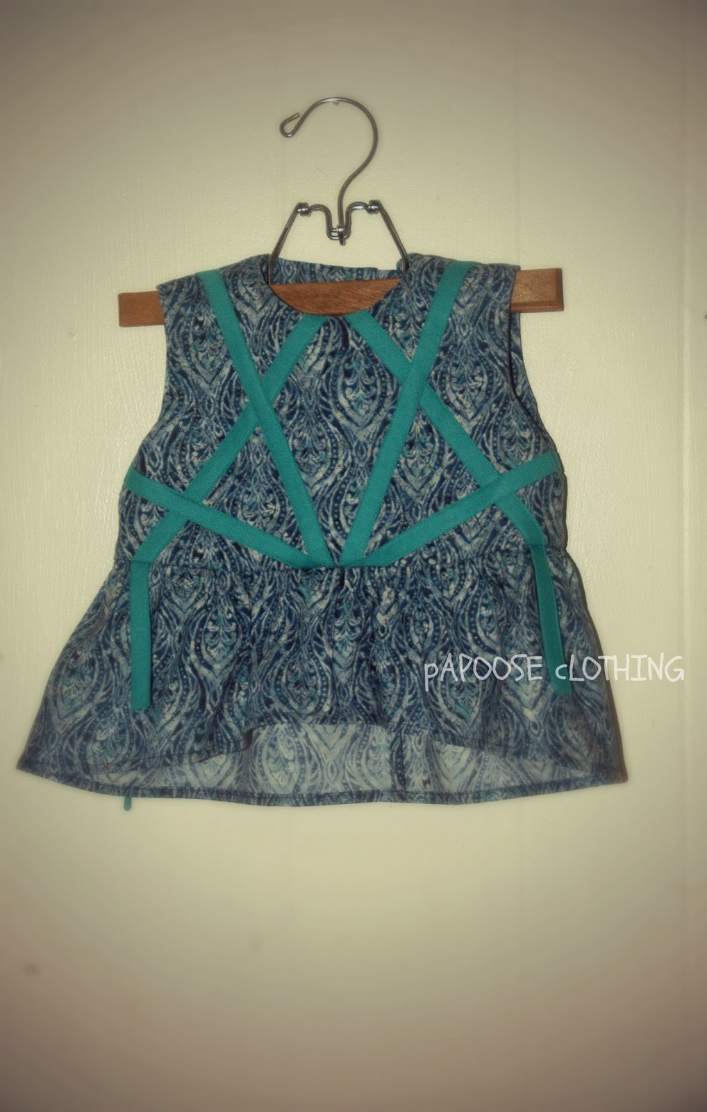http://www.papooseclothing.com/store/p36/Banjo_Blues_Tunic_Peplum_Blouse.html
