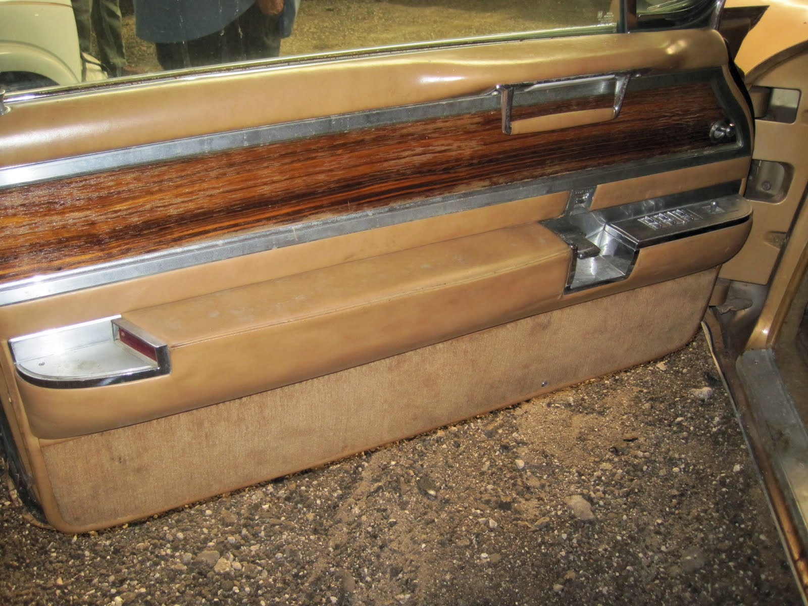 Totally custom door panel unique door handle attached to special rolled cove beautiful custom wood inlays front and rear that match the dash and look at