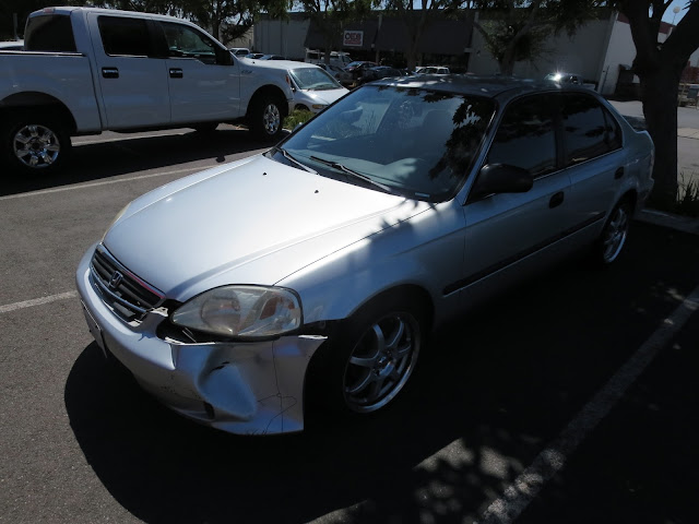 Dented Civic before collision repairs at Almost Everything Auto Body