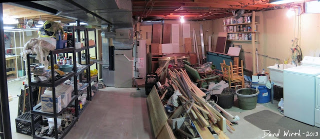 basement hoarders, junk, woodshop in basement, work, shelf