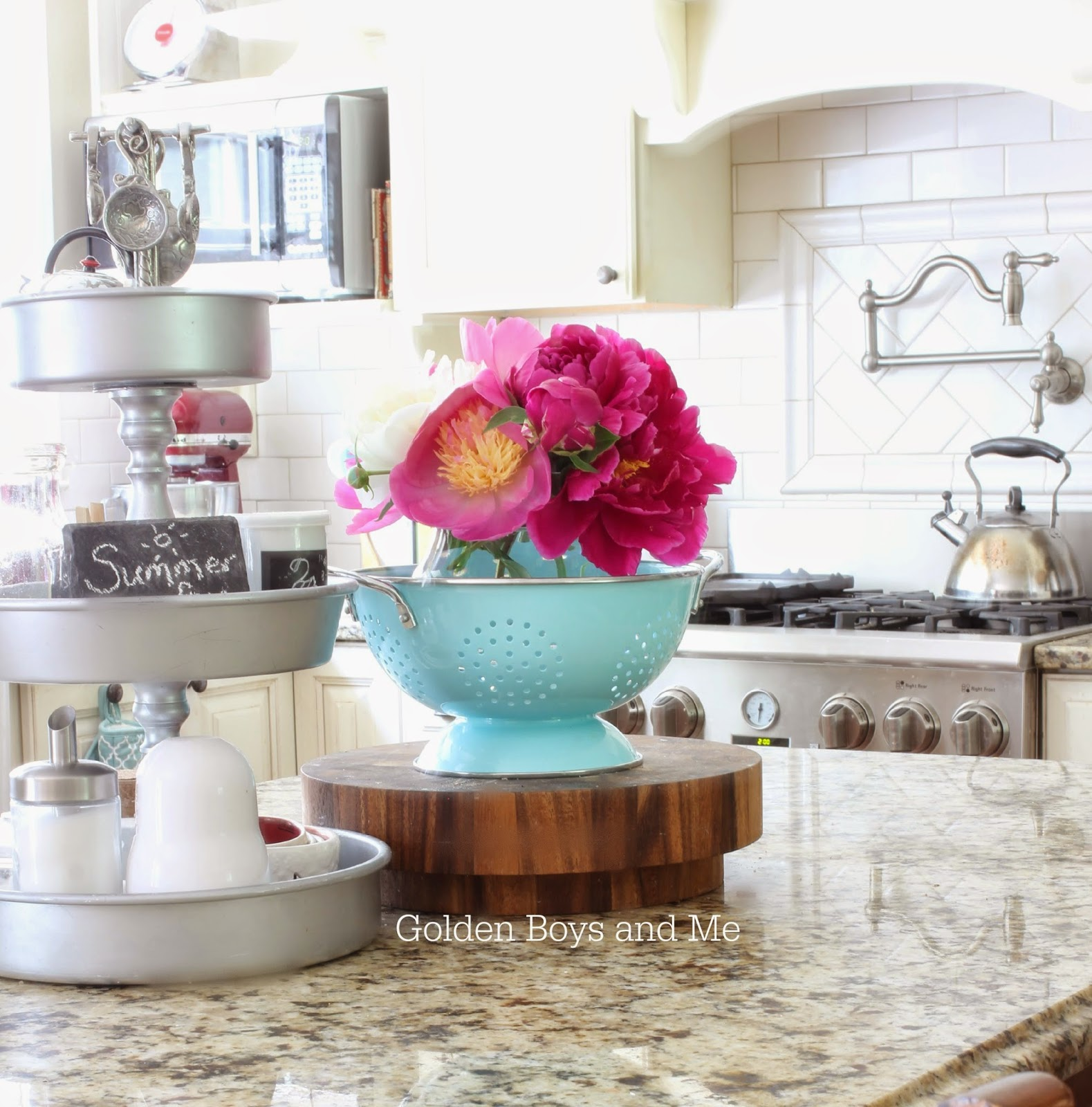 fresh cut flowers peonies displayed in a kitchen colander-www.goldenboysandme.com