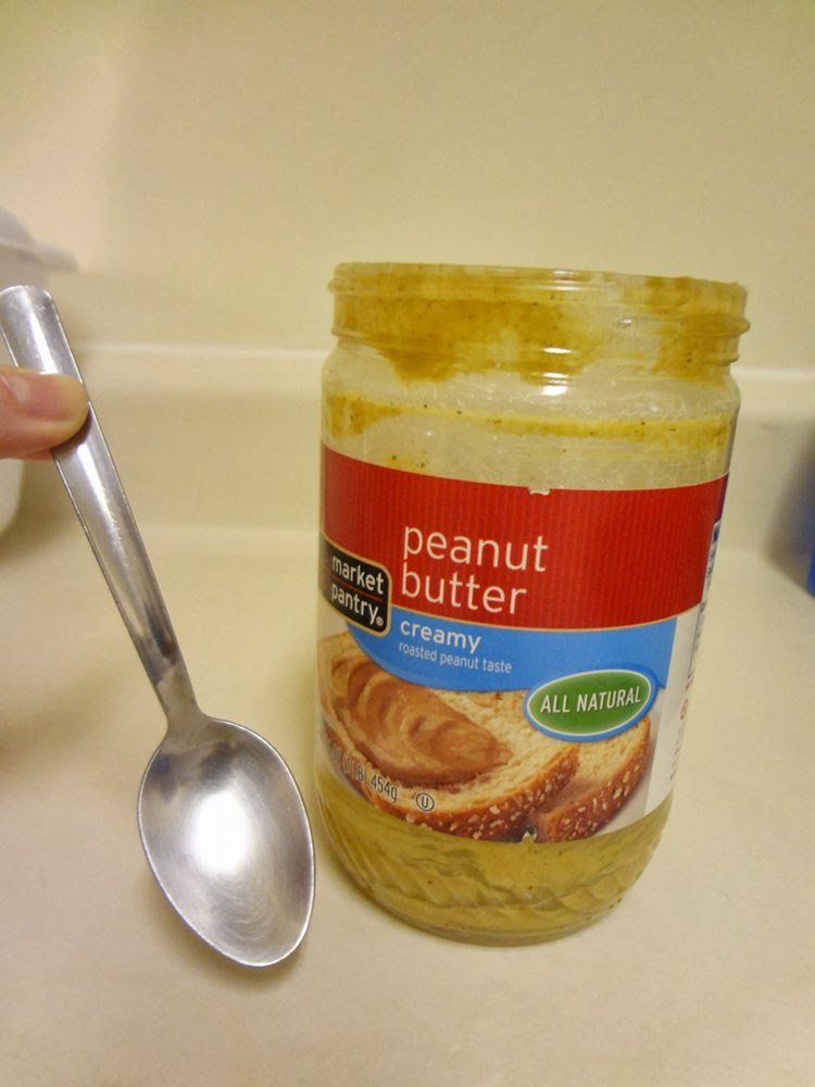 Place teaspoon into soapy peanut butter jar.