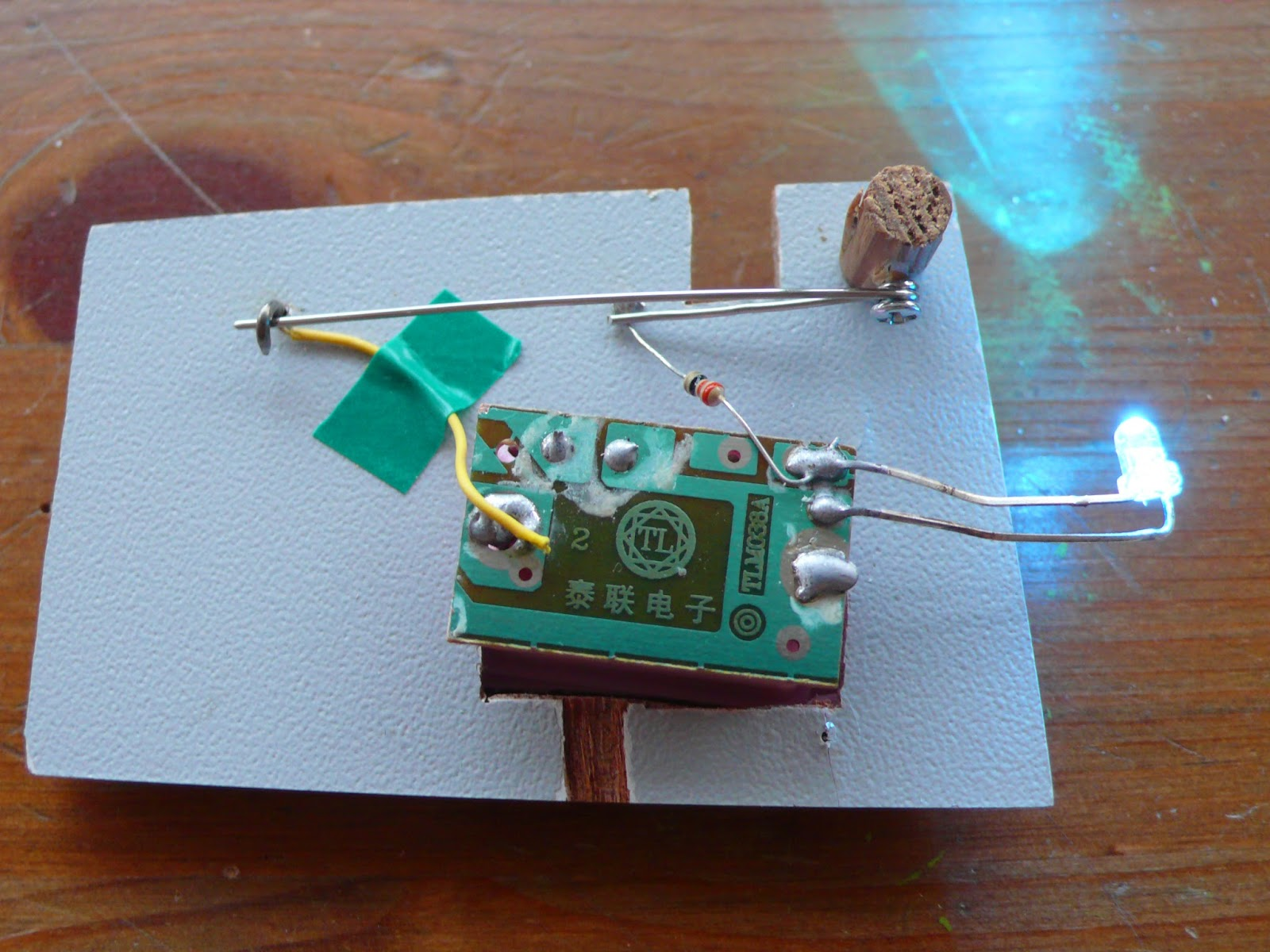 A prototype of a brooch pin which acts as a switch for an electrical circuit, here the brooch pin is closed and the light is on.