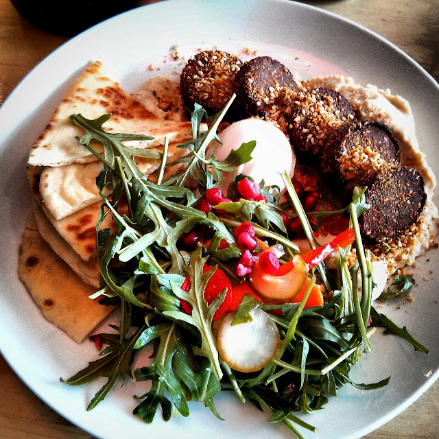 Coriander spiced falafels, hummus, pickled vegetables, flatbread and poached eggs