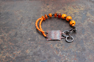 orange shaman rockpainting bracelet
