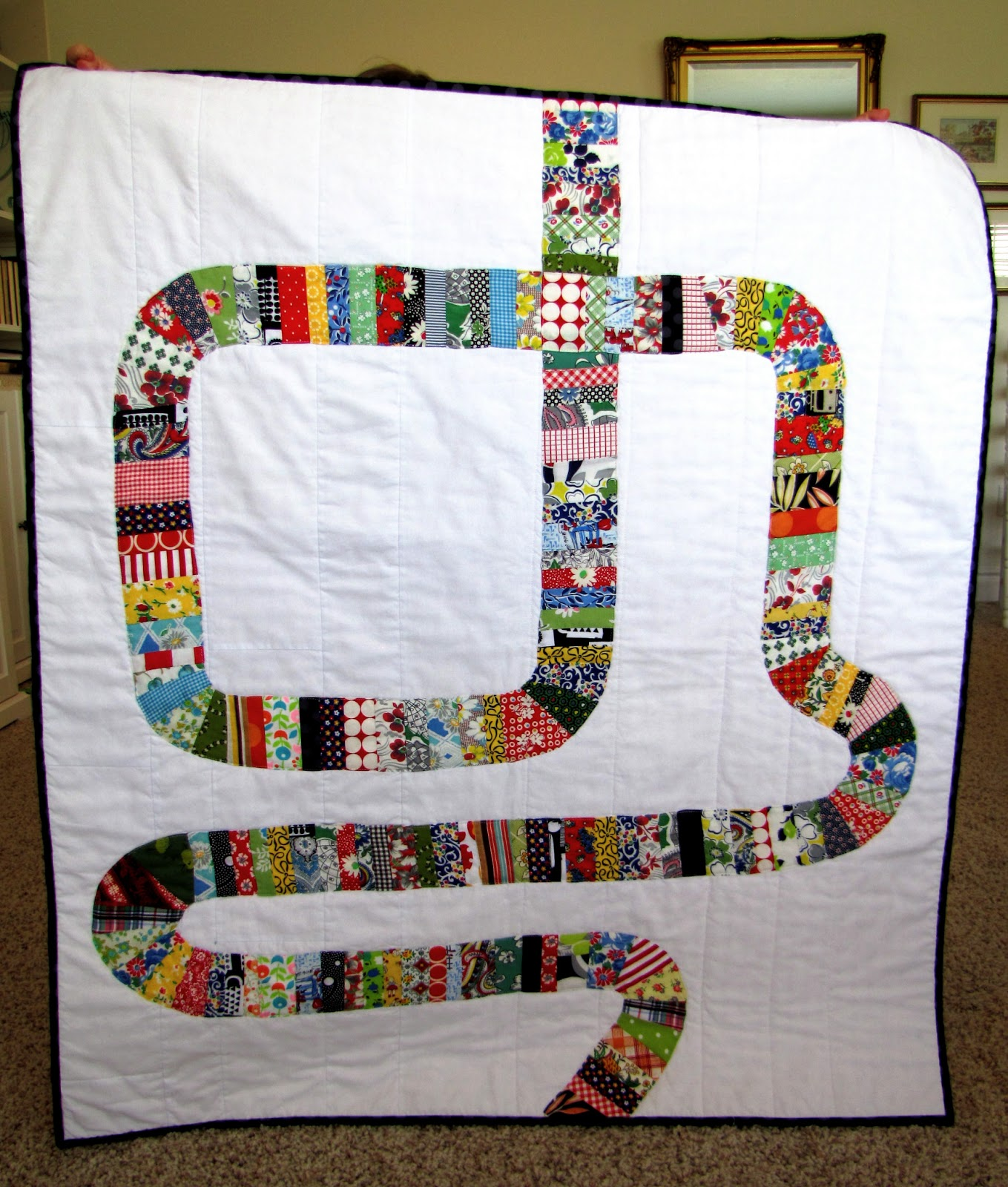 http://snippysisters.blogspot.com/2013/06/road-to-recovery-quilt-for-joyces.html