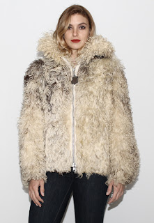 Vintage 1970's bohemian shaggy marbled cream colored mongolian fur coat with zip front closure.