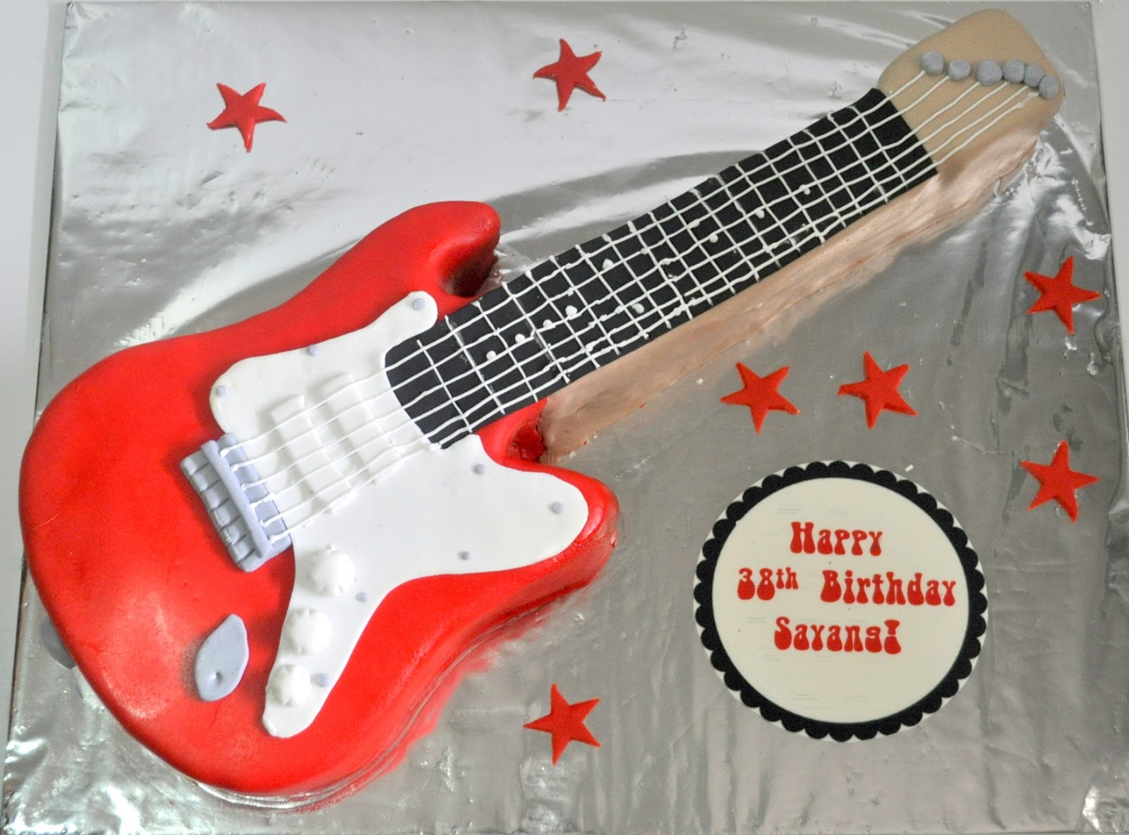 Izahs Kitchen Guitar Shaped Cake