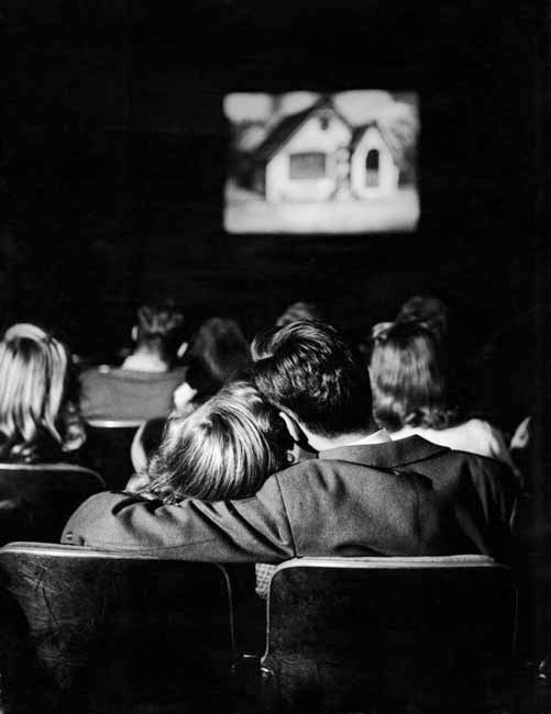 A teenage couple at the movies, circa 1944. By Nina Leen