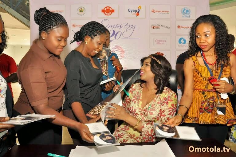 omotola autograph signing abuja