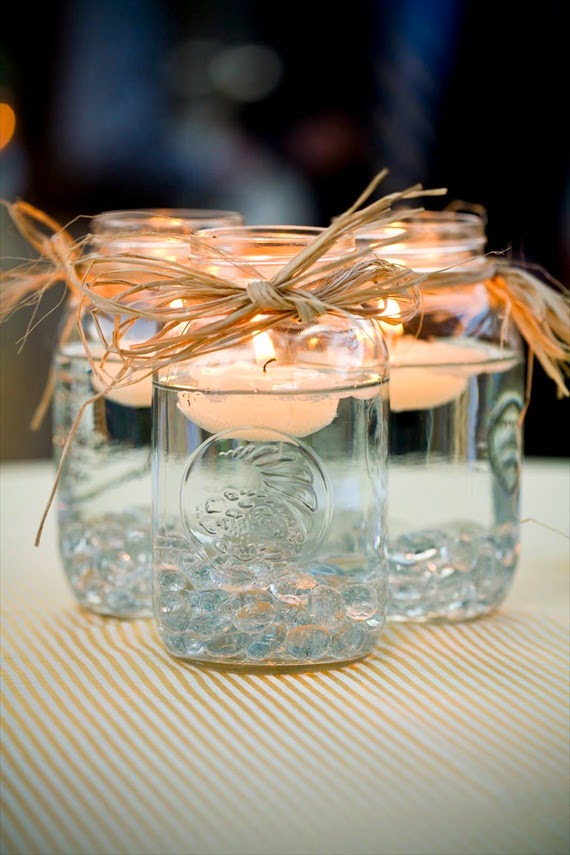 http://emmalinebride.com/handmade-wedding/mason-jar-centerpieces-floating-candles/