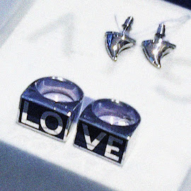 "Givenchy earrings and ""Love"" rings at Barneys."