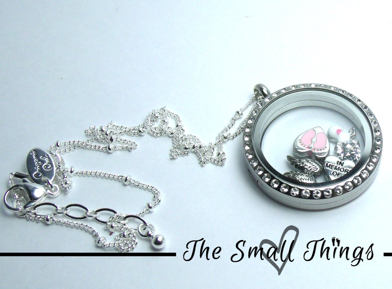 Origami owl living locket review and giveaway the small things the locket that i chose is the large silver locket with crystals it can be purchased for 28 the chain that i chose was the silver ball station chain jeuxipadfo Image collections