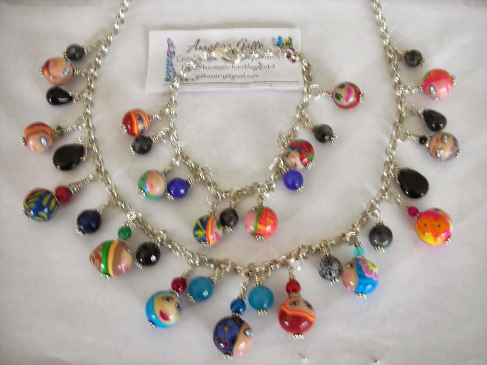 collana e bracciale con perle in fimo decorate con murrine faccine