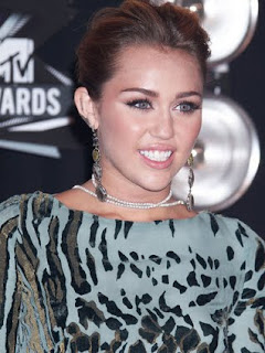 Miley Cyrus upset over bikini photos