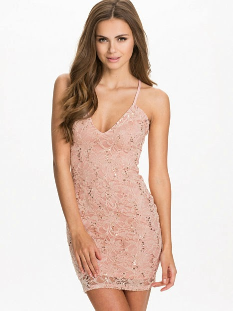http://nelly.com/ww/womens-fashion/clothing/party-dresses/oneness-1115/v-strap-sequin-dress-117883-1173/