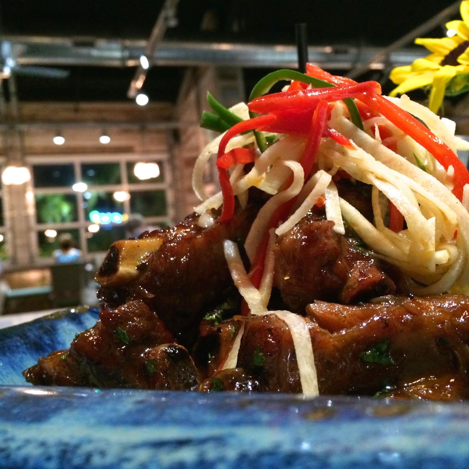 Braised Sticky Sweet Pork Ribs topped with Homemade Jicama Slaw served over Cheese Grits